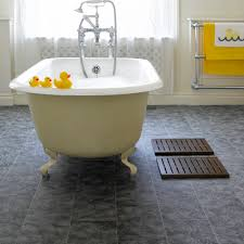 grey bathroom cork flooring and white clawfoot freestanding bathtub also anti slip mat in bathroom design ideas