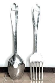 large metal spoon wall hanging