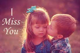 small boy kissing girl ...