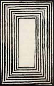 satara striped border black area rug