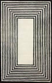 satara striped border black area rug