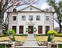 Example of a large classic two-story brick gable roof design in Dallas
