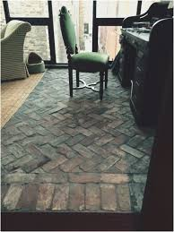 brick floor tile in basketweave pattering makes a great statement in this space