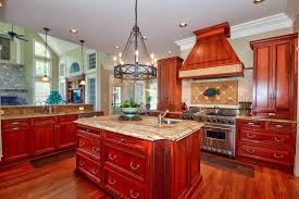 traditional kitchen with custom range hood and cherry cabinets