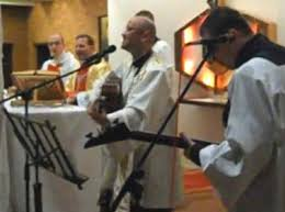 Image result for priest with guitar at mass