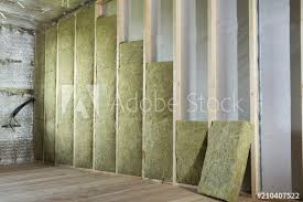 wooden frame for future walls insulated with rock wool and fiberglass insulation staff for cold barrier