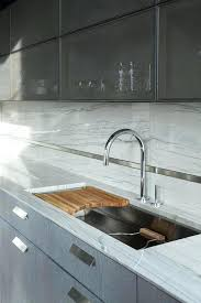 kitchen sink with cutting board metal mesh cabinets curved elkay