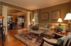 Traditional Living Room with Columns, Crown molding, Hardwood floors, Carpet