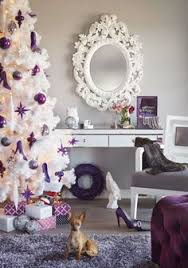 Urban Barn Holiday 2013 - Create a more feminine Christmas tree this year  with purple ornaments on the white Vegas tree.