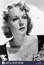 Portrait of the American actress Rita Johnson. She has curly chin-length  hair Stock Photo - Alamy