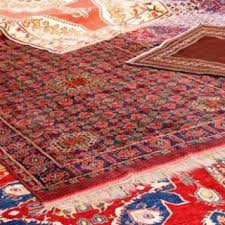 rug carpet. an authentic oriental rug is a handmade carpet that either knotted with pile or woven without pile. carpet-weaving dates back to ancient persia and