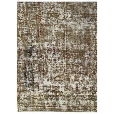 distressed vintage persian rug with modern design in shades of green