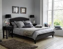 decorating a bedroom with dark gray walls