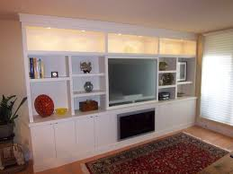 wall cabinets living room   upper display cabinets with puck lights, and  lower storage with