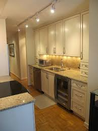 Galley Kitchen With Track Lighting Fixtures