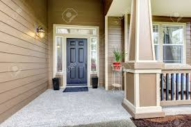 entrance porch with black door column and railings porch decorated with flower pots stock