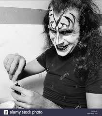 gene simmons of the rock group kiss applying makeup at the make up center in