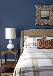 azure blue wall color with white tartan bedding set for eclectic bedroom decorating ideas