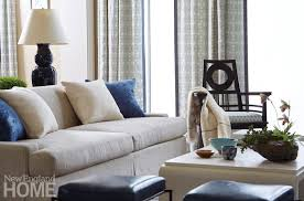 the designer insists pieces like the living room sofa and chair be as comfortable as they are good looking