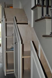 chic sliding rack for under stair storage completion
