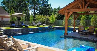 l shaped swimming pool designs with pergola plans and waterfall plus using teak wood lounge chairs furniture