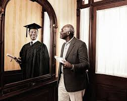 black man looking in mirror. mirror black man.jpg man looking in o