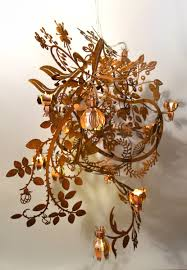 botanical is a meandering laser cut chandelier with various distinct tord flower and leaf motifs the illuminated copper and brass flowers highlight the