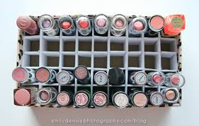 And here's how it looks filled up! I still have a few slots left to fill.  On the bottom I have all my nude lipsticks, and on the top I keep corals ...