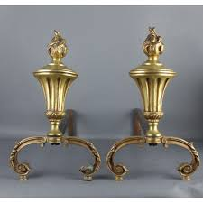 a pair of french antique brass fireplace andirons