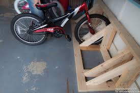easy diy bike rack tutorial to organize your garage now remodelaholic com via heatherednest