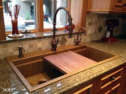 copper top mounted signature series workstation sink with american black walnut cutting board and waterstone s traditional pull down faucet in distressed