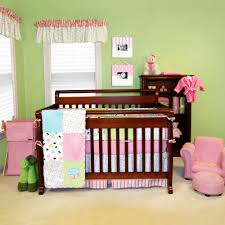 amusing baby nursery interior with cupcake themed bedding set and cherry wood baby crib