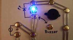 picture of build a simple circuit from a pizza box no soldering