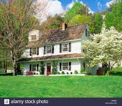 Great Exterior View Of Front Of Three Story White Frame House With Cedar Shake  Shingles And Flowering Dogwood Tree Property Released