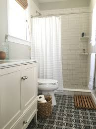 bathroom with patterned ceramic floor tile white subway tile and white vanity that homebird