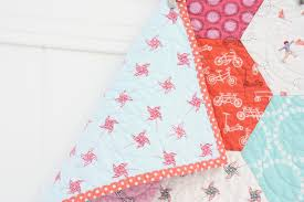 Hexagon baby quilt & It's so fun now that we can play with her art via fabric as well. I threw  in a few more prints in the colors she chose and I love the way it's turned  out. Adamdwight.com