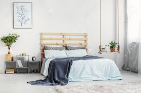Bright Bedroom Interior With King Size Bed With Light Blue Bedding