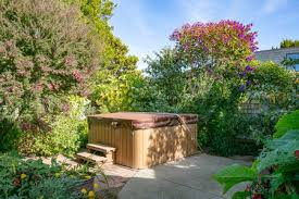 hot tub in garden of home during the day with no people closed cover