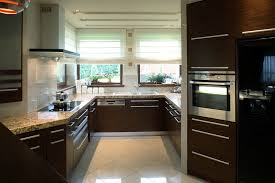 kitchen decorating ideas dark cabinets. Plain Dark This Unusually Shaped Kitchen Uses The Large Window To Bring Natural Light  Into Room On Kitchen Decorating Ideas Dark Cabinets K