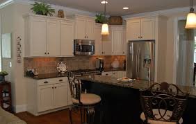 kitchen corner on pastel wall paint black glass tile backsplash white cabinets countertops what color walls