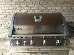 the grill is resting in an opening cut out of the granite counter top there is nothing combustible underneath it beside or behind it