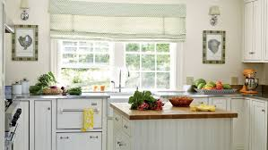 white cottage kitchens. White Cottage Kitchen, Featuring Cabinets, Sconces And An Orange Stand Mixer Kitchens