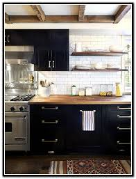 butcher block countertops with black cabinets
