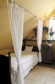 Neat idea for slope ceilings - wish I had done this when I had an attic  Sloped  Ceiling BedroomRooms With Slanted ...