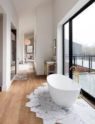 Wood tile flooring bathroom Wood Grain The Spruce 15 Ideas For Wood Floors In Bathrooms