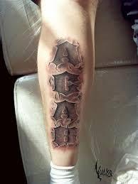 фото тату буквы в камне татуировки и эскизы надписи