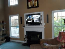 mounting tv over fireplace where to put cable box