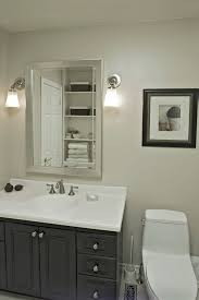 bathroom lighting and mirrors. Home Depot Bathroom Lighting Wall Sconces With Silver Framed Mirror Above Undermount Sink And Mirrors
