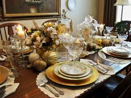 Golden themed Christmas table decorated with flowers and golden balls