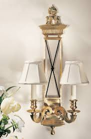 brass wall sconce with black trim lions and flame motif wall decor ideas wall